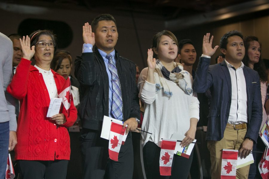 VANCOUVER, CANADA - JULY 1:  Sixty new citizens from 26 countries swear their allegiance to their new nation during a special Canada Day ceremony on July 1, 2016 in Vancouver, British Columbia, Canada.  Vancouver, the largest city in the province, celebrates the country's 149th Canada Day with music, food, a parade, and fireworks in and around Canada Place, the waterfront convention centre. (Photo by George Rose/Getty Images)