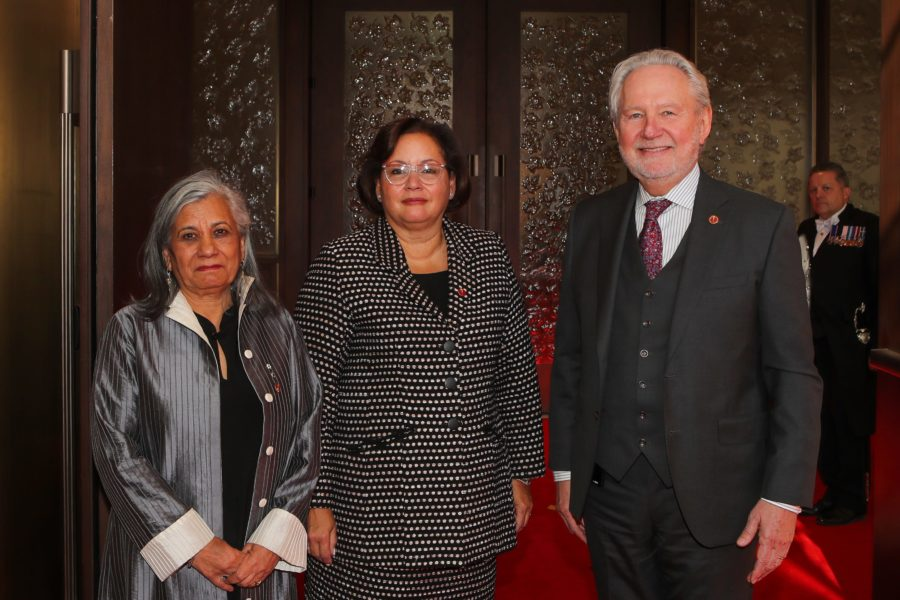 Sen. Rosemary Moodie (centre) is welcomed to the Red Chamber for the first time on February 19, 2019 by Sen. Ratna Omidvar (left) and Sen. Peter Harder (right). (Photo: Greg Kolz)