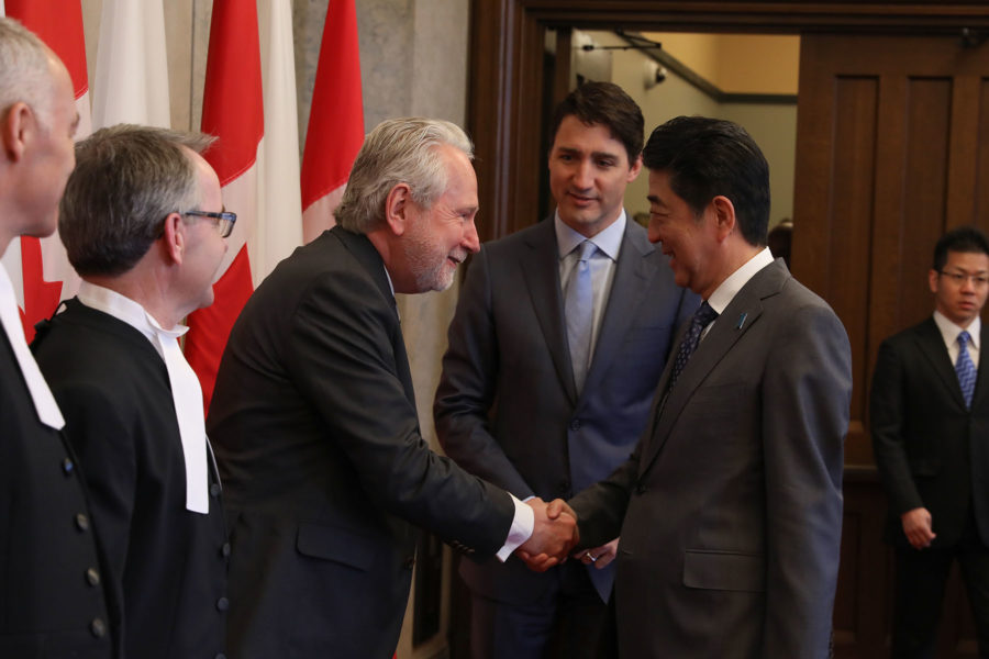 Senator Peter Harder greets Prime Minister of Japan Shinzo Abe on Parliament Hill on April 28, 2019.
