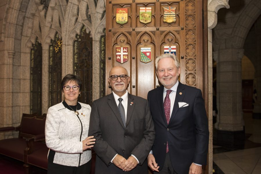 Senator Mohamed-Iqbal Ravalia (centre) is welcomed to the Red Chamber by Senator Kim Pate (left) and Senator Peter Harder (right) on June 4, 2018. (photo: Senate Communications)