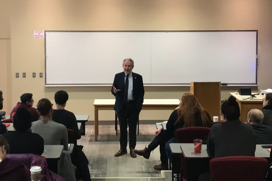 Senator Peter Harder speaks to a political science class at Memorial University in St. John's on March 26, 2019.
