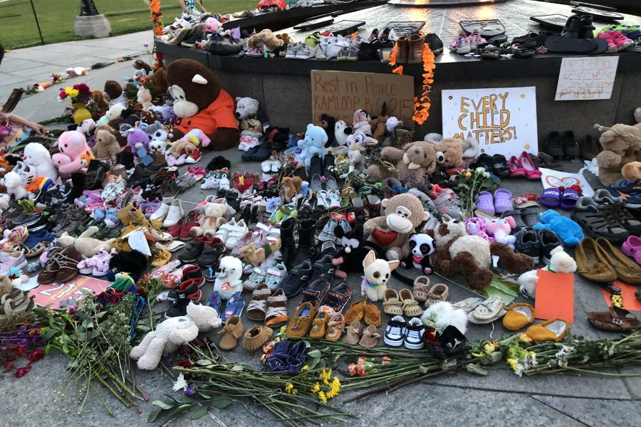 A memorial is set up on Parliament Hill following the discovery of the remains of 215 children at the Kamloops Indian Residential School.